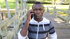 African American Male Reacts after Receiving Bad News on the Phone Stock Footage