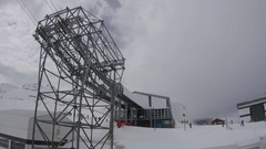 Cable car station on top of the mountain covered with snow, which come Stock Footage
