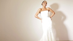 Women in wedding dresses in bridal boutique posing for camera Stock Footage