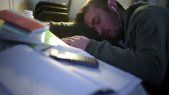 Passed Out College Student Rests on Desk Stock Footage