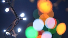 Detail of Christmas tree with electric light by night, rack focus Stock Footage