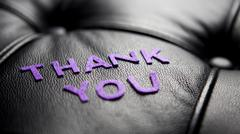 The word Thank You in black leather Stock Photos