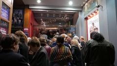 4K Cinema goers waiting outside of cinema Plaka Downtown Athens Greece Europe Stock Footage