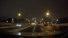 Driving through big city highway winter at night 4k Stock Footage