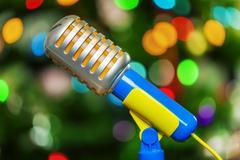 Karaoke toy microphone on bokeh Stock Photos