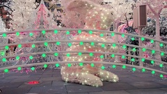 Large white faux rabbit new year in Christmas scene in town square Stock Footage