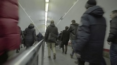 The crowd is on the large underground passage. Rear view Stock Footage