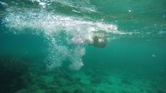 A woman swims undersea in sunny day in Aegean sea in Greece Stock Footage