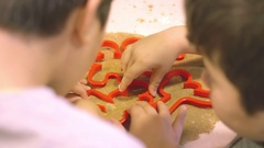 Kids using cookie cutters Stock Footage