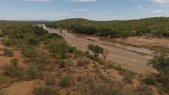 Areal view of a dirty river in the middle of the south african bush Stock Footage
