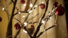Pan across the cristmas tree: Christmas bells Stock Footage