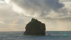 Isolated basalt rock near from coast of Reykjanes peninsula, Iceland, cloudy sky Stock Footage
