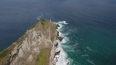 Aerial view of a rocky tongue. Wild coast. Waves hit the rock. Stock Footage