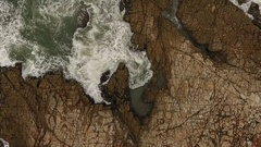 Aerial view of a rocky coast. Wild ocean. Stock Footage