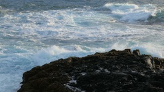Close up of wave is breaking of rocky coast on south-west edge of Reykjanes Stock Footage