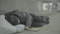 Beggar a homeless man sleeping Stock Footage