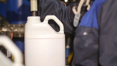 A canister with a dangerous liquid at the plant Stock Footage