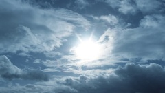 Dark Cloudy Blue Sky With Sun Shining Time Lapse Stock Footage