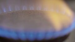 Gas cooker with burning gas on the kitchen stove Stock Footage