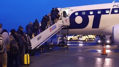WARSAW, POLAND - DECEMBER, 23 People boarding LOT airlines plane on the airfield Stock Footage