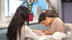 Woman manicure master doing manicure Stock Footage