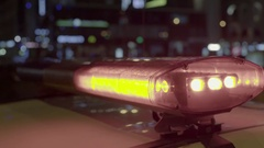 Red blue flashing light on the roof of the car at night . Close-up Stock Footage