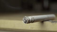 A cigarette slowly smolders Stock Footage