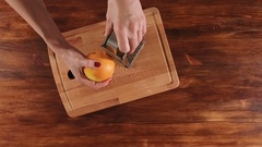 Woman prepare orange peel for dessert dish Stock Footage