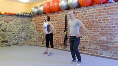 Fitness training with personal trainer at fitness center Stock Footage