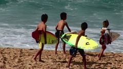 Young Surfers on Beach North Shore Oahu Hawaii Stock Footage