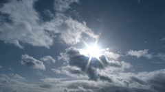 Wide Angle Sun Burst On Cloudy Blue Sky Stock Footage