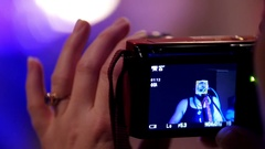 Photographer woman's hand holding gadget during a rock-concert Stock Footage