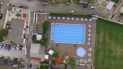 A swimming pool, aerial video. Vertical video, the camera moves away Stock Footage
