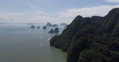 Aerial view of beautiful limestone rock formations in the sea Stock Footage