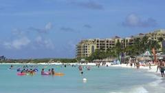 Tourists on tropical beach - Caribbean island, Aruba Stock Footage