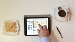 Real-estate agent showing house plans on electronic tablet Stock Footage
