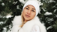 Portrait of young beautiful blonde in winter forest Stock Footage