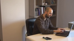 Freelance work from home office business male typing laptop key customer service Stock Footage