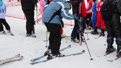Skiers on skis preparing for departure in slalom race Stock Footage