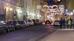 People walking on a street in the Graz lighted with Christmas decorati Stock Footage