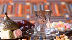 Turkish tea is poured into the traditional dishes on the table oriental sweets. Stock Footage