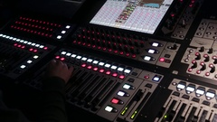 The work of the sound engineer behind the mixing Desk at the concert. Stock Footage