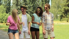 Two young couples dancing, singing and jumping at outdoor summer music festival Stock Footage