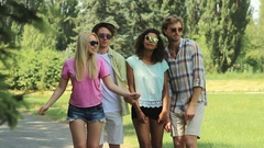 Friends posing for picture to be taken on summer trip, making funny movements Stock Footage