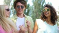 Young couples enjoying their time at music festival, singing, dancing together HD Footage