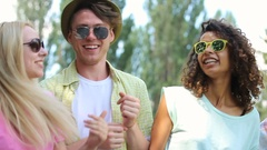 Young couples enjoying their time at music festival, singing, dancing together Stock Footage