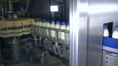 Fresh dairy products, bottles moving on a conveyor. Milk products plant Stock Footage