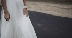 Detail of hand bride in wedding dress,she is walking, slow motion. 4k Stock Footage
