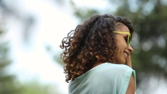 Nice-looking biracial lady dancing and flirting by putting down her sunglasses Stock Footage