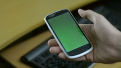 White Phone Screen Touched In Right Hand Greenscreen Stock Footage